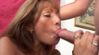 Erotic blonde milf Estrella Spangled sucking a large cock head with lust