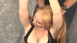 Chained blonde slave in attractive corset Tori will get gagged up