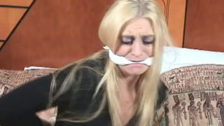 Platinum blonde woman Keli Anderson getting tied up on the lodge room